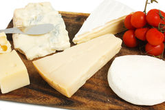 Composition of cheese. On cutting board Stock Images