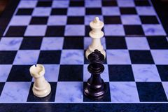 Composition of the chess pieces on a chess board Stock Image