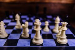 Composition of the chess pieces on a chess board Royalty Free Stock Photo
