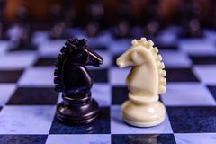 Composition of the chess pieces on a chess board Royalty Free Stock Photos