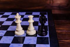 Composition of the chess pieces on a chess board Stock Photos