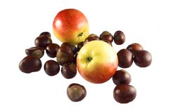 Composition of chestnuts and apples I Stock Photography