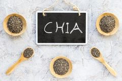 Composition with chia seeds on white background. Chia written in blackboard royalty free stock photography