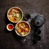 Composition of chinese food. Mixed kinds of dumplings from wooden bamboo steamer stock image
