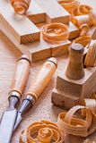 Composition chisels woodworkers plane shavings Royalty Free Stock Image