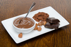 Composition of chocolate hazelnut spread, hazelnuts, chocolate a Stock Image