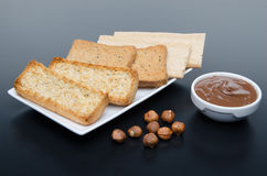 Composition of chocolate hazelnut spread, hazelnuts and differen Royalty Free Stock Image