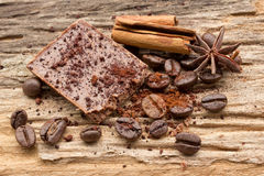 Composition of chocolate sweets, cocoa, spices and coffee bean Royalty Free Stock Image