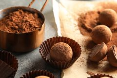 Composition with chocolate truffles on grey. Background royalty free stock image