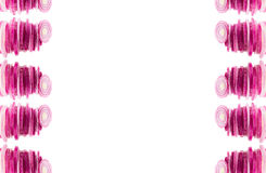 Composition of chopped pink onion. Border of pyramids  pink onion.  Frame with copy space. Concept art. Pattern. Royalty Free Stock Image