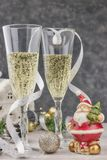 Composition with Christmas decorations and glasses filled with sparkling champagne. new year, table theme. horizontal view, close- stock photo