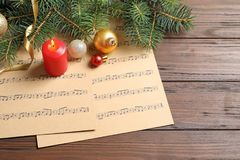Composition with Christmas decorations and music sheets. On table royalty free stock photography
