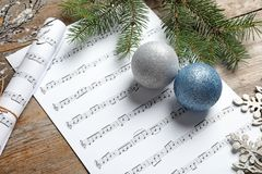 Composition with Christmas decorations and music sheets stock images
