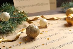 Composition with Christmas decorations and music sheets on table stock images