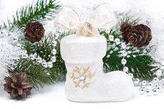 Composition with Christmas decorations - white boots, fir branch Stock Photo
