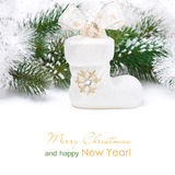 Composition with Christmas decorations - white boots, isolated Royalty Free Stock Photo