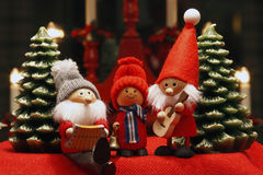 Composition of Christmas Figurines. Composition of seasonel Christmas Figurines with symbol background Stock Photos