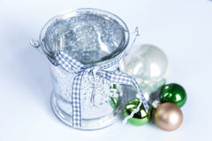 Composition of the Christmas green balls and candle. On white background Royalty Free Stock Photos
