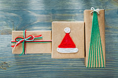 Composition of Christmas present boxes on wooden board holidays Stock Photography