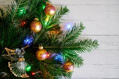 Composition with a Christmas tree, an angel, beautiful balls and royalty free stock photo