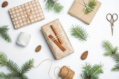 Composition with Christmas tree branches and gift boxes. On white background royalty free stock photos