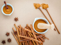 Composition of cinnamon stick and cinnamon powder in white morta Royalty Free Stock Images