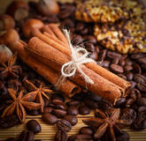 Composition of cinnamon sticks, coffee beans, anise, hazelnuts a Stock Photography