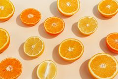 Composition of citrus fruits cut in half on a light yellow background. Top view. Organic group diet exotic healthy ripe ingredient natural tropical closeup royalty free stock image