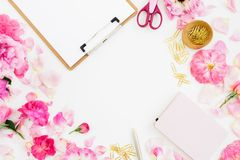 Composition with clipboard, notebook, accessories and pink flowers on white background. Flat lay, top view. Copy space. Composition with clipboard, notebook royalty free stock photography