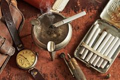 Composition with clock and cigarettes in a retro style Stock Images