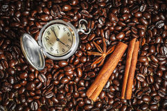 Composition with clock, cinnamon and star anise Stock Photography