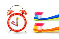 Composition from clock, toothbrushes with toothpaste. Composition from red clock, toothbrushes with pink toothpaste isolated on white background Royalty Free Stock Images