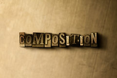 COMPOSITION - close-up of grungy vintage typeset word on metal backdrop Royalty Free Stock Photos
