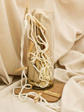Composition with clothespins, cord and vase. Against beige textile background Royalty Free Stock Image