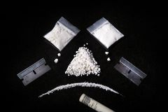 Composition of Cocaine, razor and rolled bill,  Ma Stock Photo