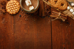 Composition of cocoa with marshmallow, biscuit cookies, anisetre Royalty Free Stock Image