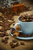 Composition of coffee beans and cup Stock Photos
