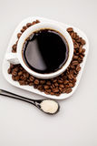 Composition with coffee cup, coffee powder, sugar and beans Stock Images