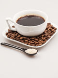Composition with coffee cup, coffee powder, sugar and beans Stock Photo