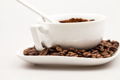 Composition with coffee cup, powder and beans Royalty Free Stock Photo