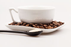 Composition with coffee cup, powder and beans Royalty Free Stock Images