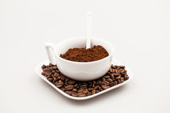 Composition with coffee cup, powder and beans Stock Photo