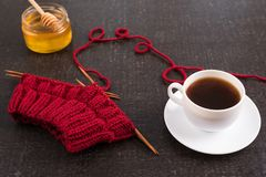 Composition with coffee, honey and knitting Stock Image