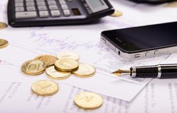 Composition of the coins, calculator and charts. Business composition of the coins, calculator and charts stock photography