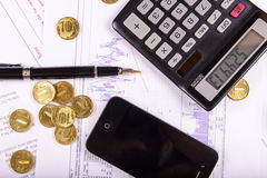 composition of the coins, calculator and charts Royalty Free Stock Photo