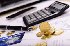 Composition of the coins, calculator and charts Stock Photo