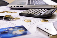 Composition of the coins, calculator and charts Stock Images