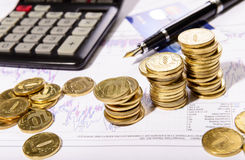 Composition of the coins, calculator and charts. Business composition of the coins, calculator and charts stock photos
