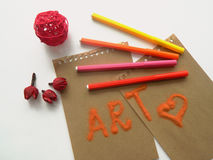Composition with coloful felt tip pens and flowers Stock Images