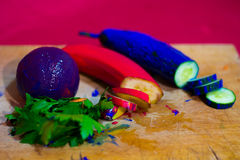 Composition of colored cucumber, banana, parsley and orange Royalty Free Stock Photos
